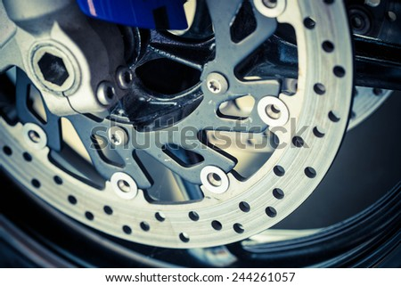 The front wheel of a motorcycle. Close up brakes and spokes - stock photo