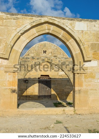 The frontage of the Church of Panagia Katholiki with its arched entrance, Kouklia, Cyprus. - stock photo