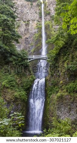 The full length of Multnomah Falls and the Benson Footbridge, near Portland, Oregon - stock photo