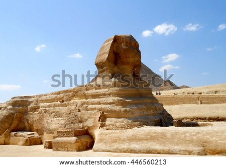 The full profile including head, feet and entire body of the Great Sphinx with the pyramid of Menkaure in the background in Giza, Egypt with nobody in frame. Horizontal copy space - stock photo