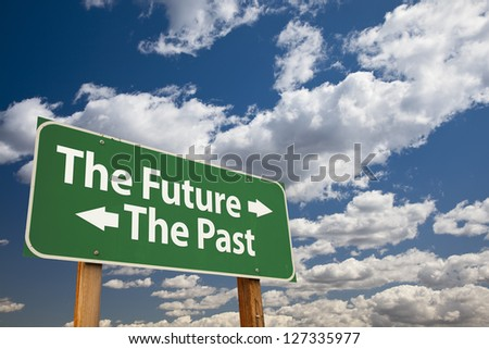The Future, The Past Green Road Sign Over Dramatic Clouds and Sky. - stock photo