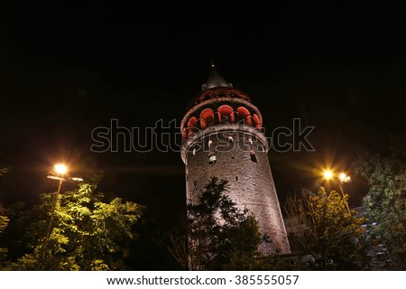 The Galata Tower shot at night.  It is located in Istanbul Turkey and was constructed in 1348 as the Christea Turris (Tower of Christ).  - stock photo