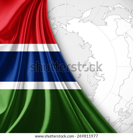 The Gambia flag and world map background - stock photo