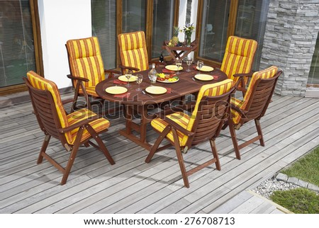 The Garden furniture by the house patio - stock photo