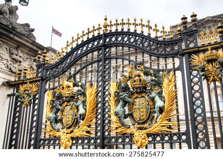 The gate in the fence with iron and gold of Buckingham Palace in London, the capital of the United Kingdom  - stock photo
