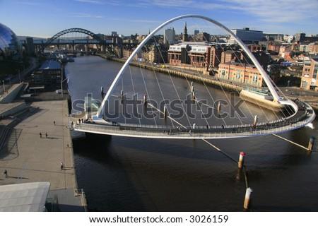 the gateshead millenium bridge and the tyne bridge captured in one shot - stock photo