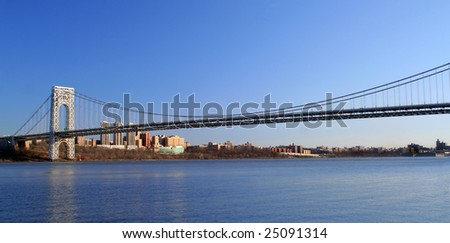 The George Washington Bridge crosses over the Hudson River from New Jersey to The Bronx, New York - stock photo