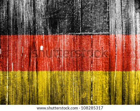 The German flag painted on wooden pad - stock photo