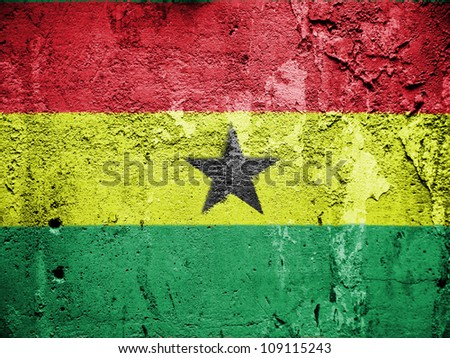 The Ghana flag painted on grunge wall - stock photo