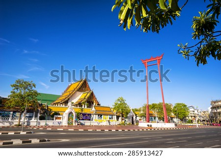 The giant swing (Sao Ching Cha) and Wat Suthat temple in Bangkok, Thailand, Sunny day cleare blue sky. - stock photo