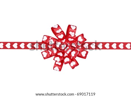 The gift decorated with a tape with hearts on the white - stock photo