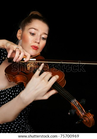 The girl and a violin - stock photo