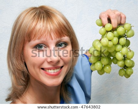 The girl and grapes. - stock photo