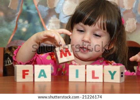 The girl and toy cubes - stock photo