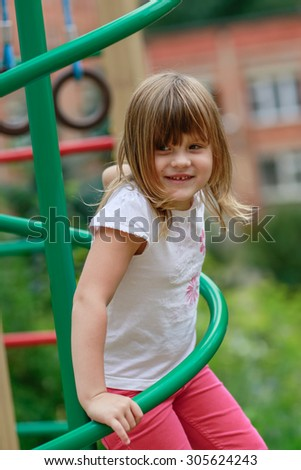the girl climbs the stairs on the Playground, close-up - stock photo