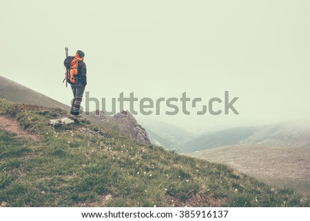 The girl explores the Alps in Piedmont, deep in te fog - stock photo