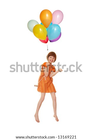 The girl flies on balloons - stock photo