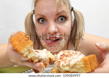 The girl greedy eats sweet pie. Unhealthy lifestyle (bulimia) concept. - stock photo