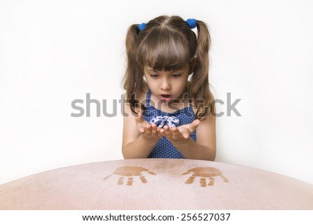 The girl hands soiled in the dust - stock photo