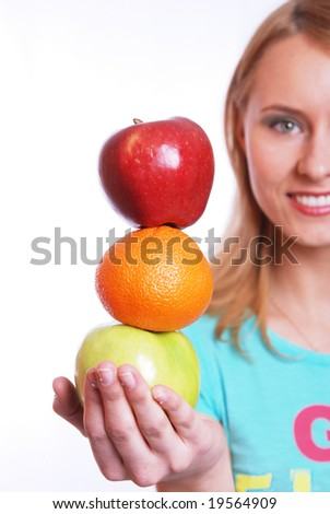 The girl holds on a palm a green and red apple with an orange - stock photo