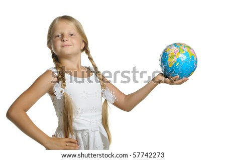 The girl holds the globe collected from puzzle in hands. It is isolated on a white background - stock photo