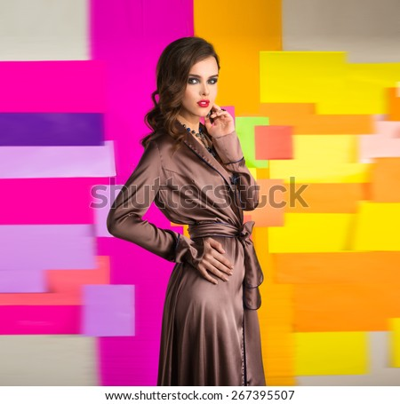 The girl in a brown robe on bright background - stock photo