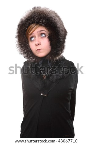 The girl in a fur cap looks aside - stock photo