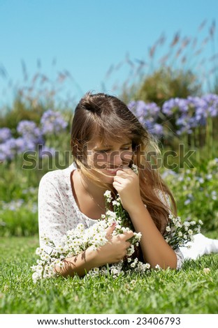 The girl in a hat with a bunch of flowers - stock photo