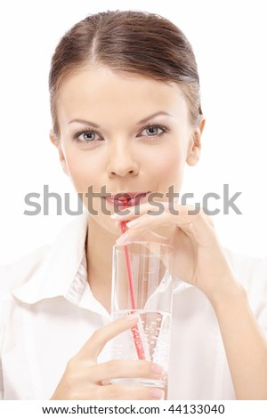 The girl in a white shirt drinks a cocktail - stock photo