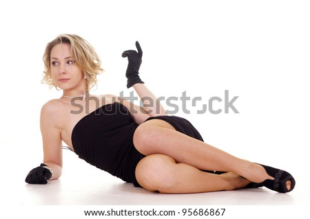 The girl in dress lying on a white background - stock photo