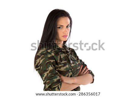 The girl in military equipment on a white background - stock photo