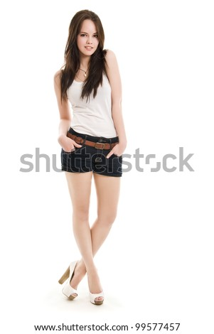 The girl in shorts standing on a white background - stock photo