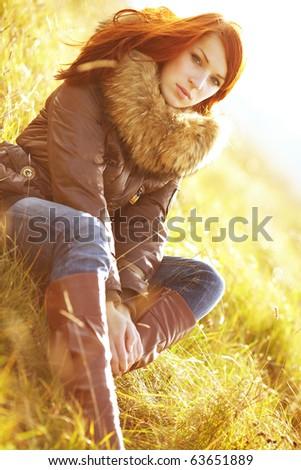 The girl in solar beams, autumn - stock photo
