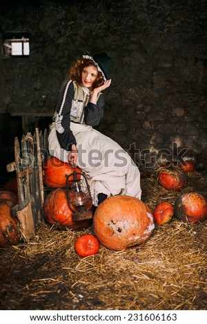 the girl in the basement of pumpkins - stock photo