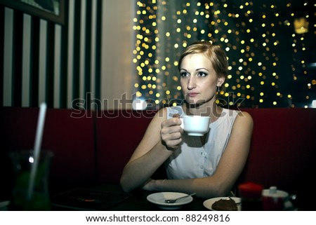 The girl in the cafe - stock photo