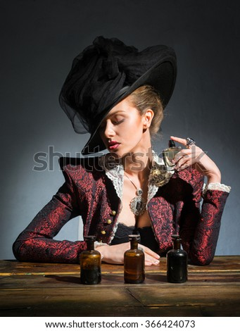The girl in the hat dushitsya spirits - stock photo