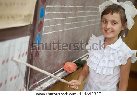 the girl in the music school at the board - stock photo