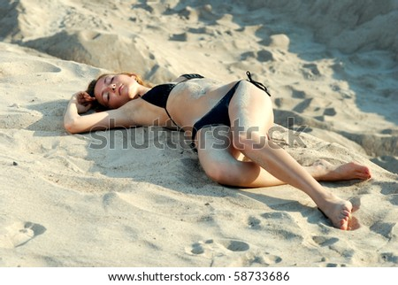 the girl in the sand. - stock photo