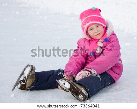 The girl in the skate on the ice. - stock photo