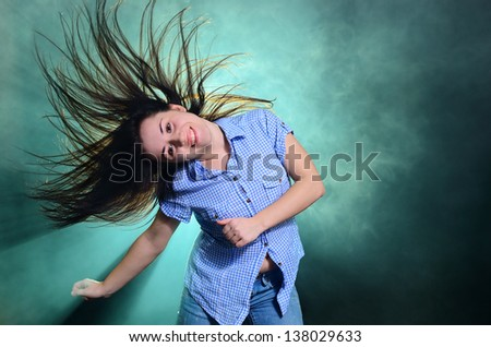 The girl in the smoke dancing with her hair - stock photo