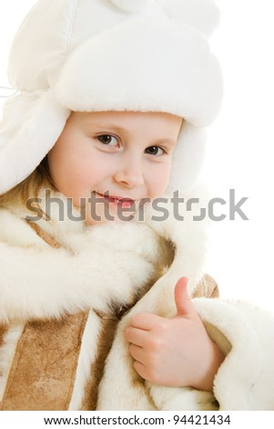 The girl in warm clothes gesture shows okay on white background. - stock photo
