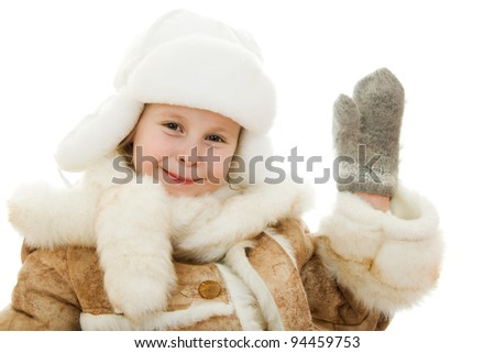 The girl in warm clothes kindly waving a hand on white background. - stock photo