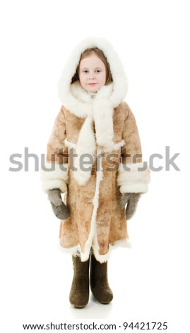 The girl in warm clothes smiling on white background. - stock photo