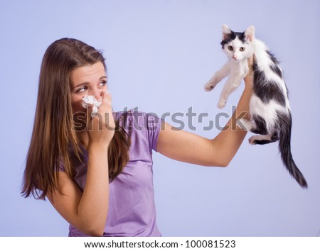 The girl is allergic to cat - stock photo