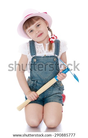 The girl is holding a garden shovel - isolated on white background - stock photo