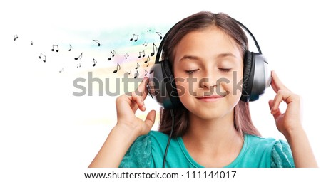 The girl  is  listening to music and close her eyes - stock photo