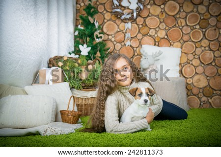 The girl is lying in the floor with the dog. Girl with dog.  children and pets - stock photo