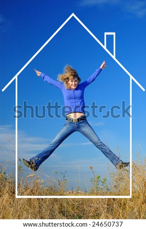 The girl jumps in the field with dreams of the new house - stock photo