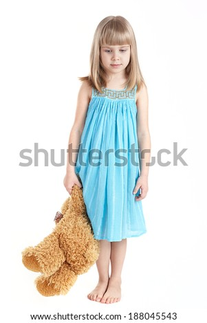 The girl keeps a toy bear  - stock photo