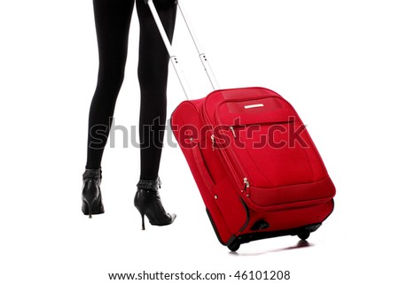 The girl legs with a suitcase on the white background - stock photo